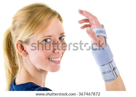 Portrait of Smiling Young Blond Woman Looking at Camera and Wearing Supportive Wrist Brace in Studio with White Background - stock photo