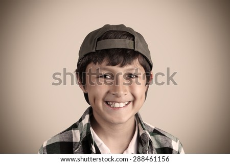 Portrait of smiling young boy with vintage look and vignetting