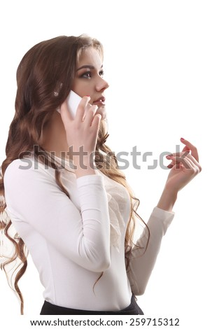 Portrait of smiling young brunette woman talking on the phone - stock photo