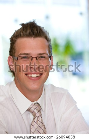 Portrait of smiling young business man - stock photo