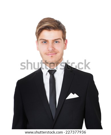 Portrait of smiling young businessman against white background