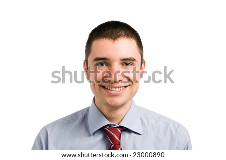 Portrait of smiling young businessman looking at camera. Isolated on white background - stock photo