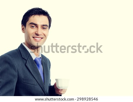 Portrait of smiling young businessman with cup of coffee, in blue tie, with blank copyspace area for slogan or text message - stock photo