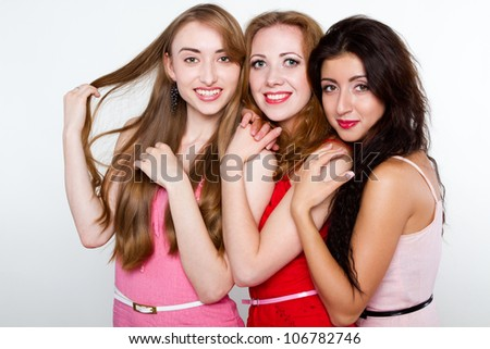 Portrait of smiling young girls isolated on white background - stock photo