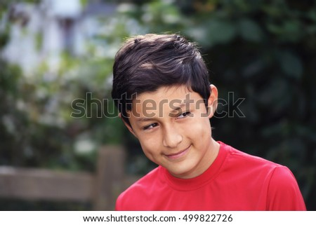 Portrait of smiling young Hispanic boy - taken with vintage lens