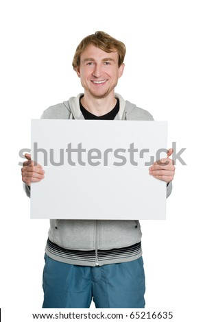 Portrait of smiling young man holding blank sign in hands - stock photo