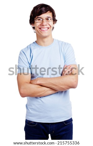 Portrait of smiling young man in glasses and blue t-shirt with crossed arms on his chest isolated on white background - stock photo