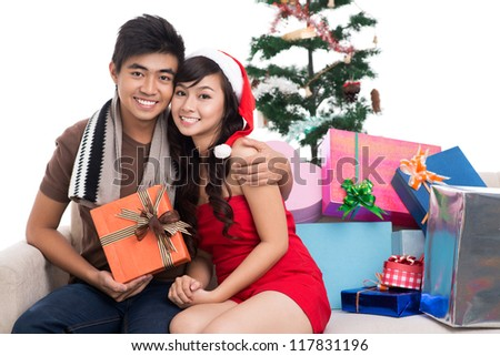 Portrait of smiling young people enjoying their first Christmas together - stock photo
