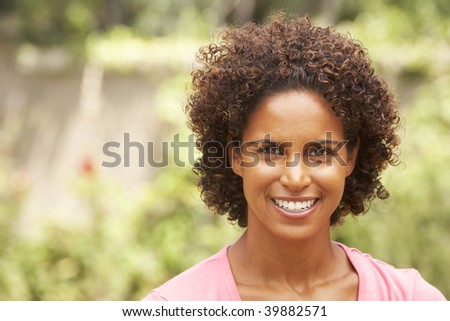 Portrait Of Smiling Young Woman - stock photo