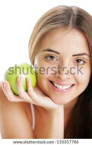 Portrait of Smiling Young Woman Holding Apple - stock photo