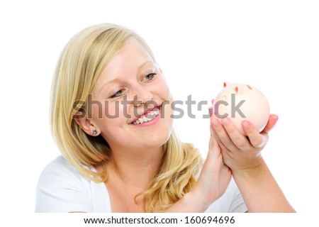 Portrait of smiling young woman holding piggy bank