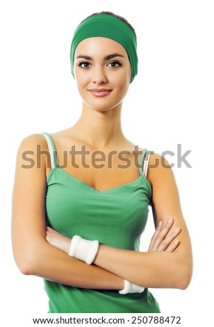 Portrait of smiling young woman in green fitness wear, isolated against white background - stock photo