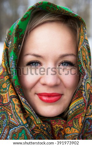 Portrait of smiling young woman in the scarf