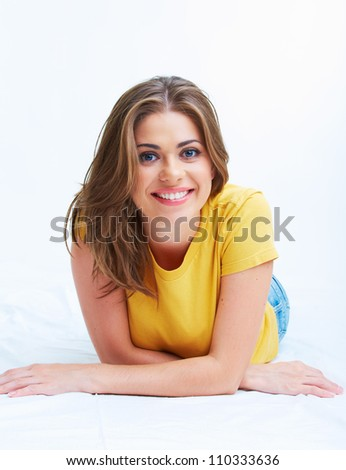 Portrait of smiling young woman lying on floor isolated on white background - stock photo
