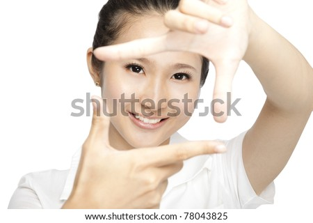 Portrait of smiling  young woman  making a hand frame isolated on white - stock photo
