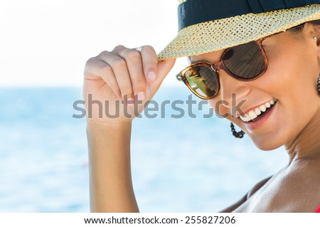 Portrait Of Smiling Young Woman Wearing Sunglasses And Panama - stock photo