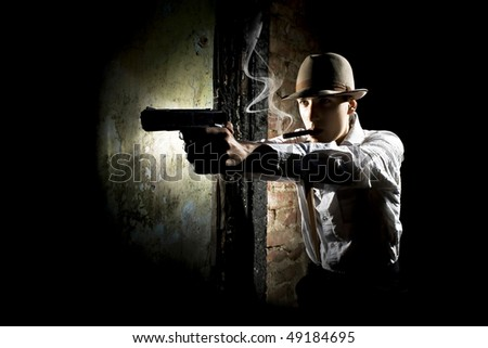 portrait of smoking detective with pistol - stock photo