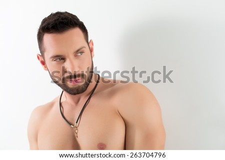 Portrait of smug bearded man posing in studio - stock photo