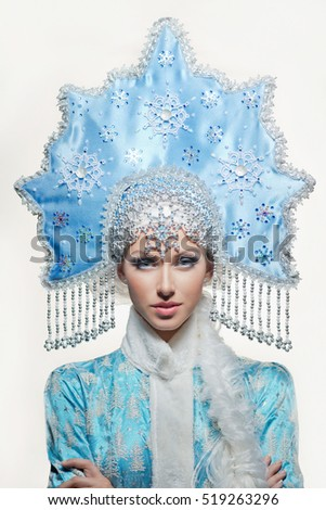 Portrait of snow maiden with a beautiful crown on the white background