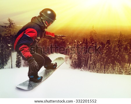 Portrait of snowboarder doing extreme trick on the mountain. - stock photo