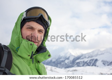 Portrait of snowboarder in high winter mountains in Gudauri, Georgia