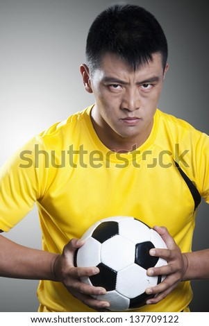Portrait of soccer player holding a soccer ball
