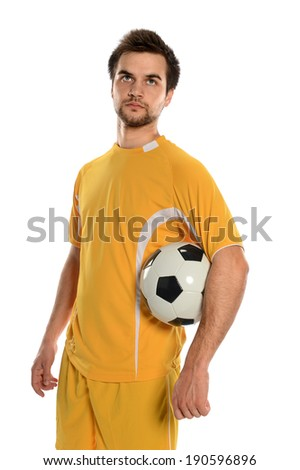 Portrait of soccer player holding ball isolated over white background