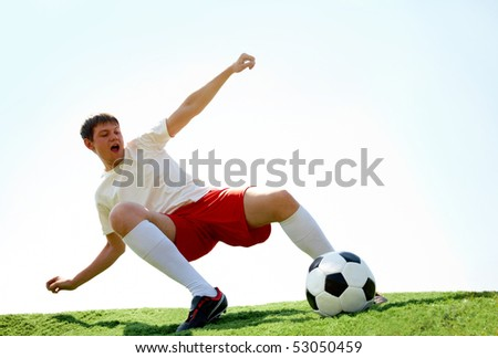 Portrait of soccer player on football field - stock photo