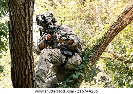 Portrait of Soldier in uniform of the U.S. Army on the trees - stock photo