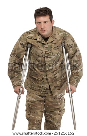 Portrait of soldier with crutches against white background - stock photo