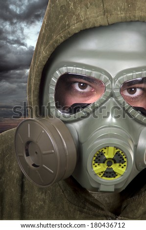 portrait of soldier with gas mask.  nuclear contamination concept  - stock photo