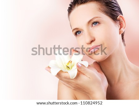 portrait of spa woman with flower