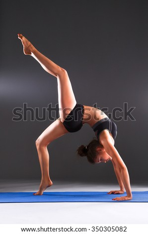 Portrait of sport girl doing yoga stretching exercise - stock photo