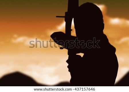 Portrait of sportswoman practising archery against sky and mountains