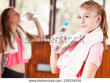 Portrait of sporty girl with bottle of water - stock photo