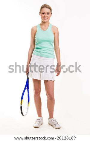 Portrait of sporty girl with tennis rocket standing on white background - stock photo