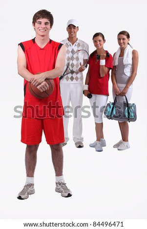 portrait of 4 sporty people - stock photo