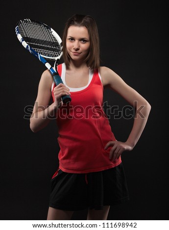 Portrait of sporty teen girl tennis player with racket - stock photo