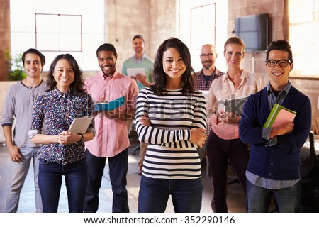 Portrait Of Staff Standing In Modern Design Office - stock photo