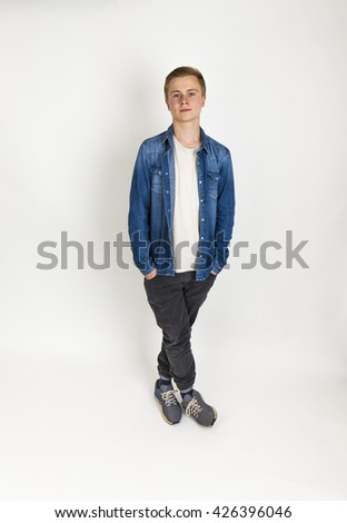 portrait of standing teenage boy  in ful length isolated on white - stock photo