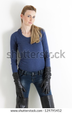 portrait of standing woman wearing jeans - stock photo