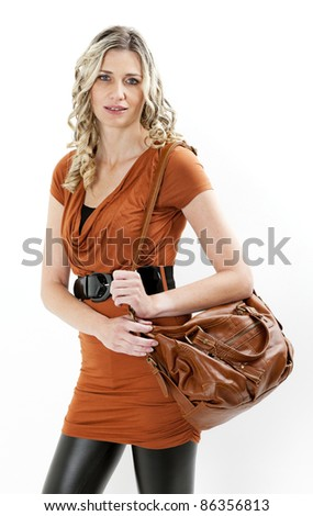 portrait of standing woman with a handbag