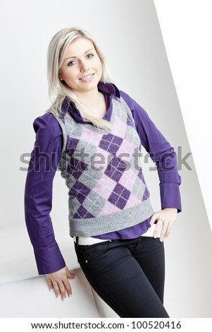 portrait of standing young businesswoman - stock photo