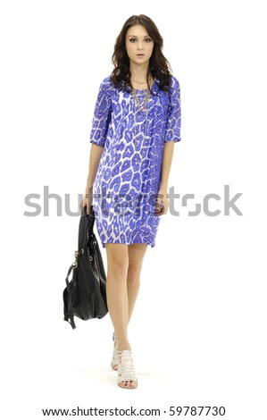 portrait of standing young woman with modern bag. Isolated on white.