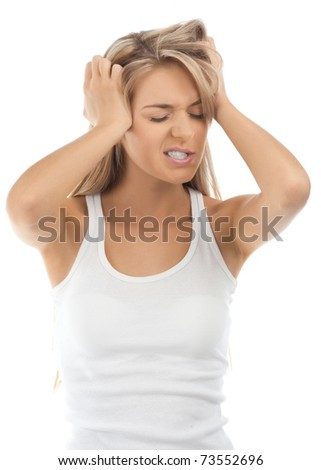Portrait of  stressed blond girl having a headache, against white background