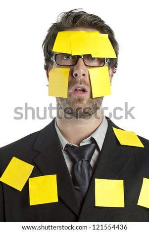 Portrait of stressed businessman covered by sticky notes against the white background