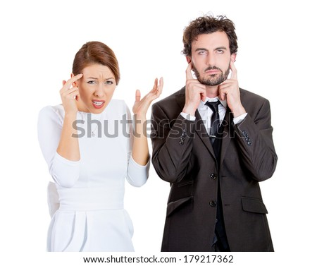 Portrait of stressed young couple going through hard times in relationship, isolated on white background. Upset, angry wife, girlfriend asking if her husband is crazy, he closes ears, looks annoyed. - stock photo