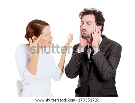 Portrait of stressed young couple going through hard times in relationship, isolated on white background. Upset, angry wife, girlfriend asking if her husband is crazy, he closes ears, looks annoyed - stock photo