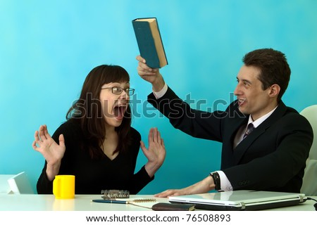 portrait of strict chief and young secretary in office - stock photo