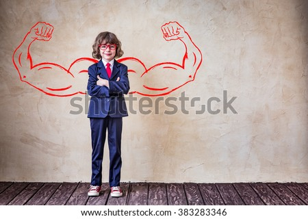 Portrait of strong businessman in office. Success, leader and winner kid - stock photo